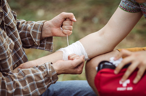 Photo: Using a First Aid Kit via Shutterstock