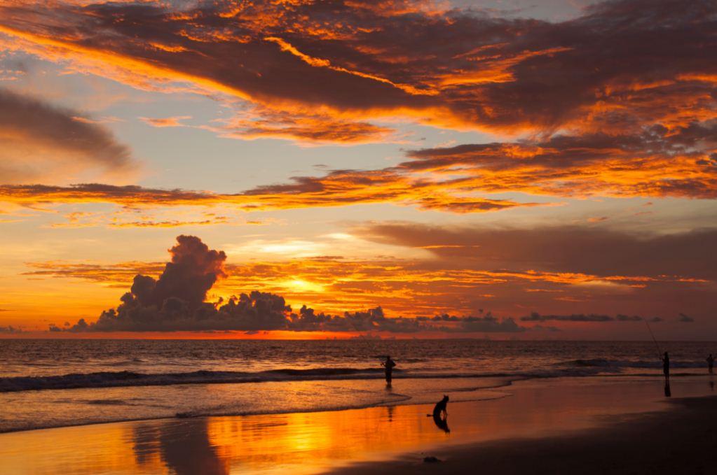 Sunset at Uluwatu temple. Image of travel blog.