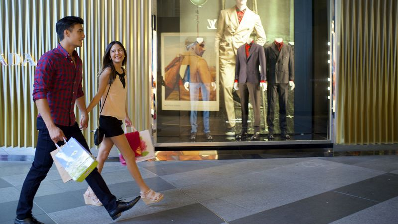 A couple outside Prada shop passing by ION Orchard
