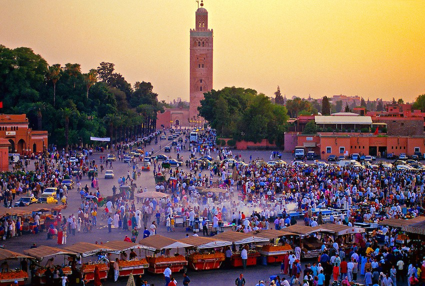 Jemaa el Fna (central square), Mosquee Koutoubia (mosque) in background, Marrakech, Morocco. Photo Blaine Harrington