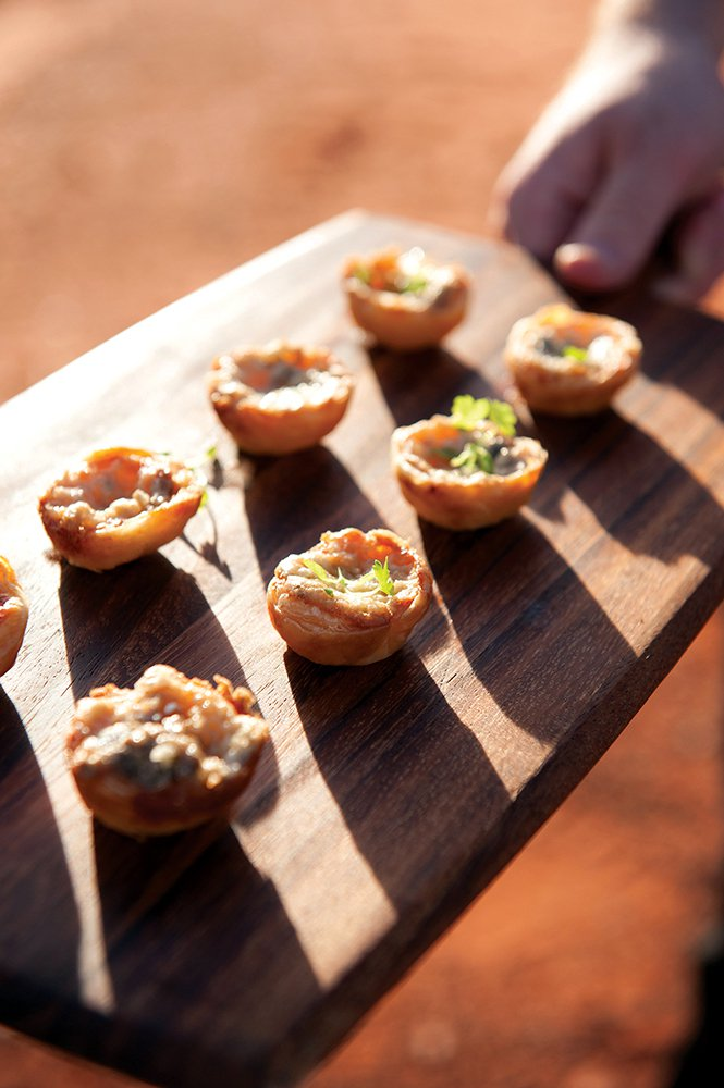 Sunset canapes and champagne kick off the Tali Wiru experience.