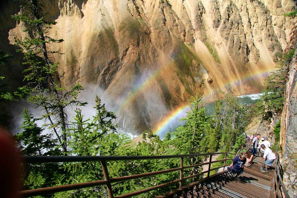 Rainbows bouncing off the spray at Yellowstone National Park's Grand Canyon. Image courtesy of Wyoming Office of Tourism.