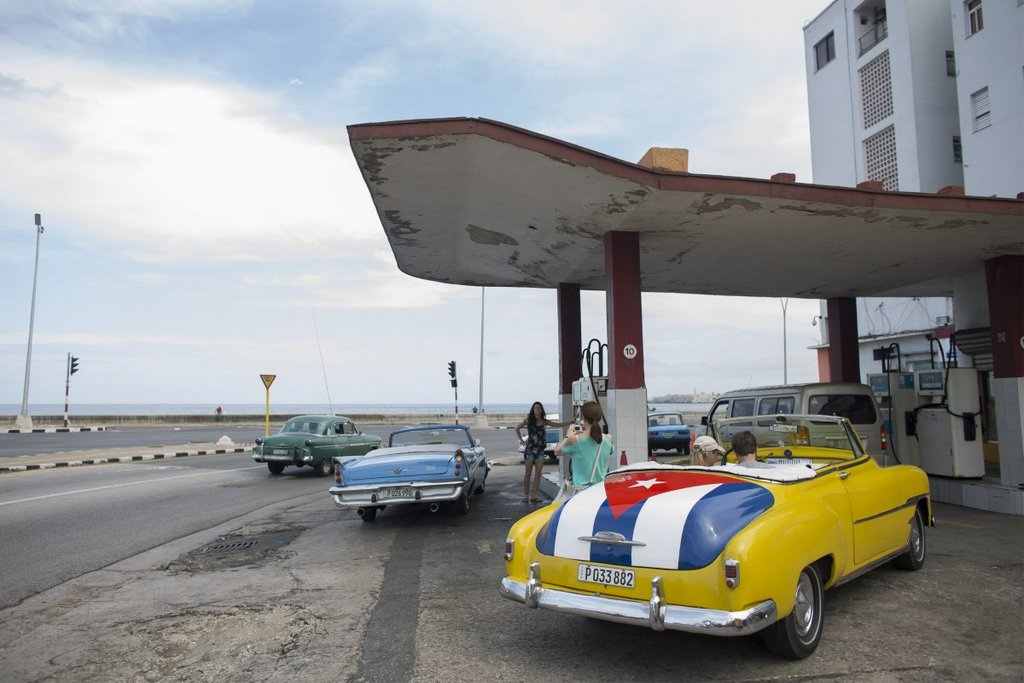 Cubans are known for their love of classic cars. Alexandre Meneghini/Reuters