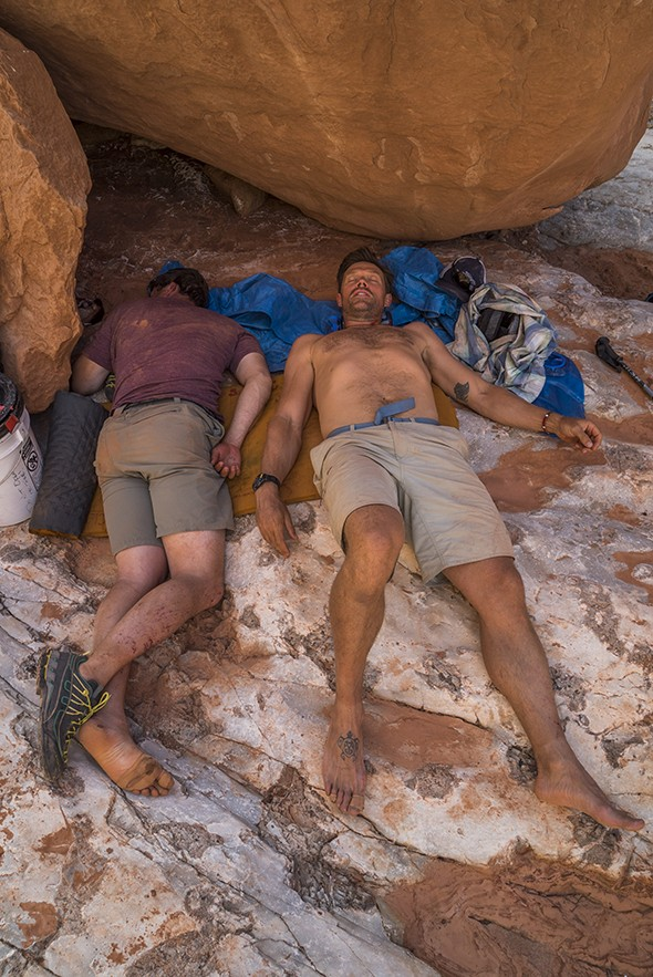 Kevin Fedarko and Pete McBride rest before hiking out early on their first leg of their sectional hike. McBride suffered hyponatremia, dangerously low salt levels.