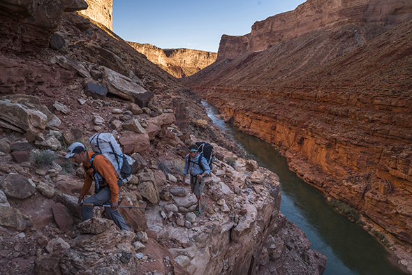 Mike St. Pierre and Kevin Fedarko negotiate the exposure on top of the Red Wall layer which cliffs out some 500-800 feet straight to the river. Marble Canyon.