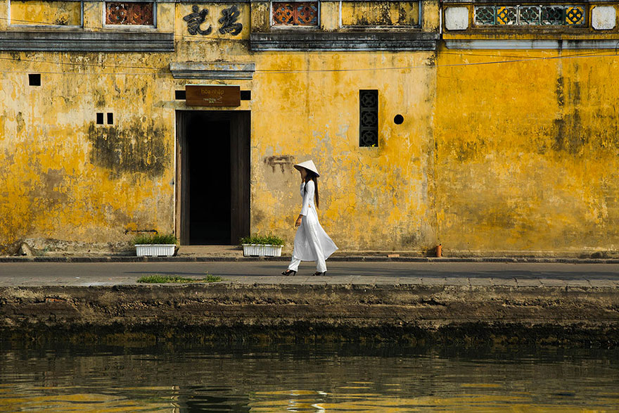 Young student wearing Ao Dai in the Old Town