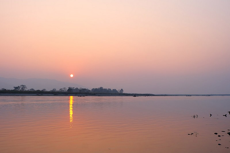 A sunset over Chitwan National Park.
