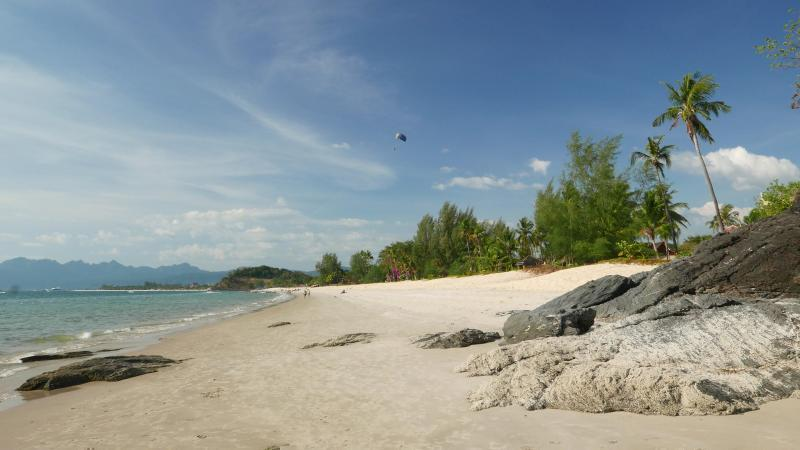 Spend your day sunbathing and doing watersports on the beaches in Langkawi.