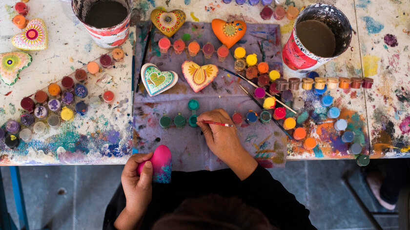A local artisan hand paints crafts at the Jocobo and Maria Angeles studio in Oaxaca.