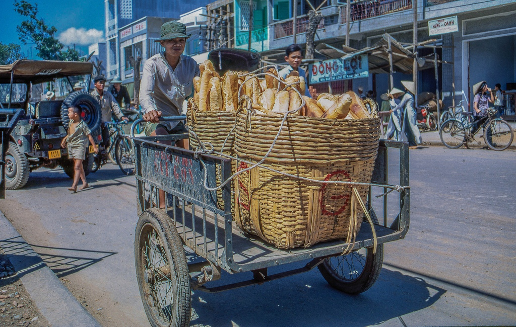 A reminent from the French colonial days, the long loaves of french bread were plentiful in My Tho. (Dinh Tuong Province, Vietnam)