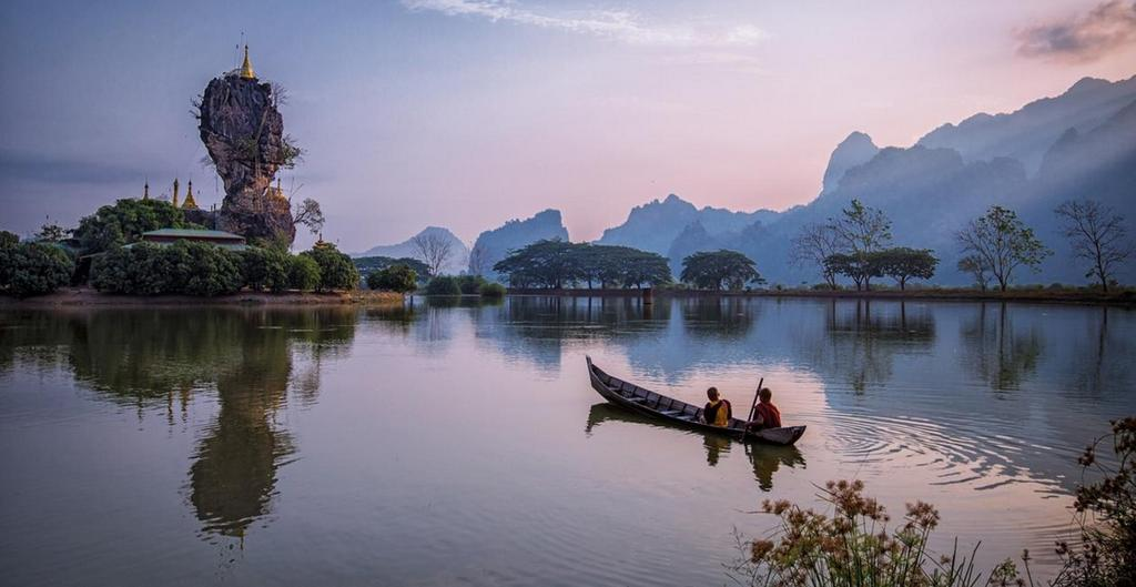 Kyauk Ka Lat Lake in Hpa-An, Kayin State, rowing toward a monastery