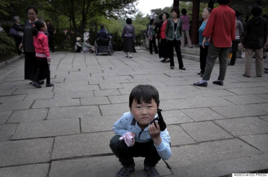 boy play pistol toy pyong yang