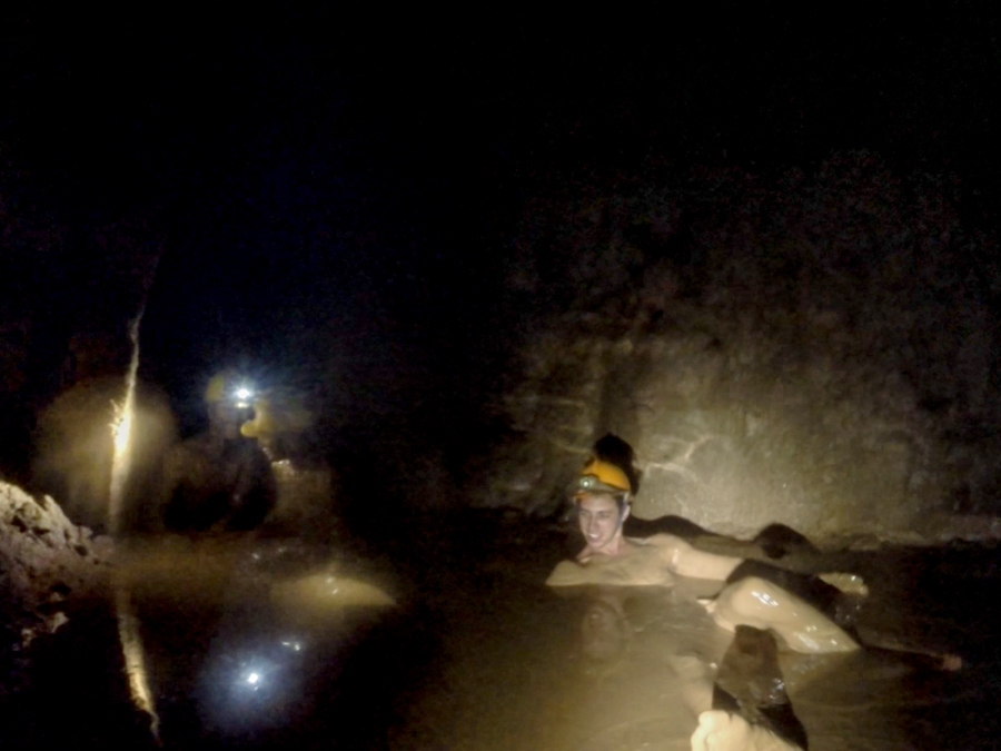 Getting filthy in the mud in Dark Cave in Phong Nha