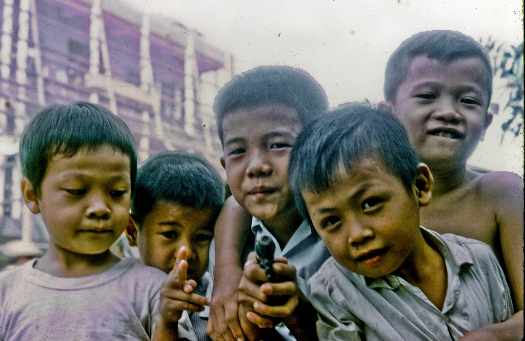 Street Brats in My Tho in 1969 On the street in front of the MACV Team 66 personnel residence, Hotel 1, in My Tho city, Dinh Tuong Province, Vietnam.