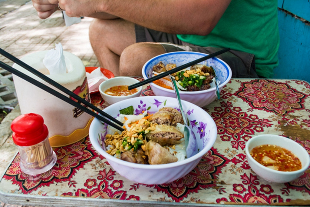 noodles with marinated char-grilled pork and egg rolls in Sai Gon