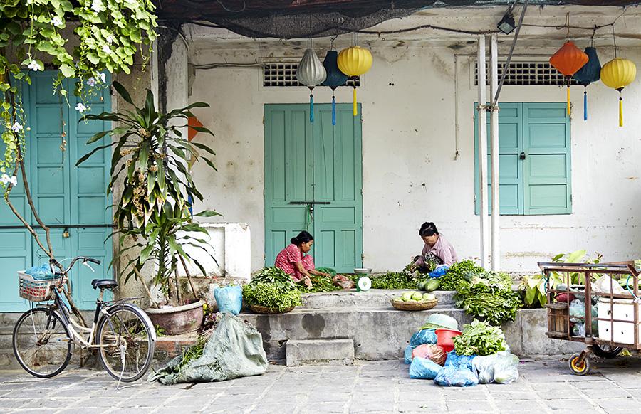 women preparing vegetables