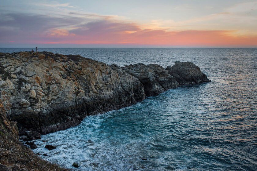 The stunning view of sunset from Punta Cometa outside of Zipolite in Oaxaca.