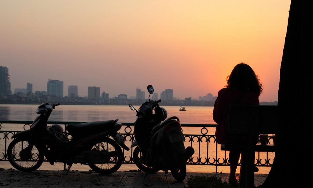 sunset at ho tay west lake hanoi y