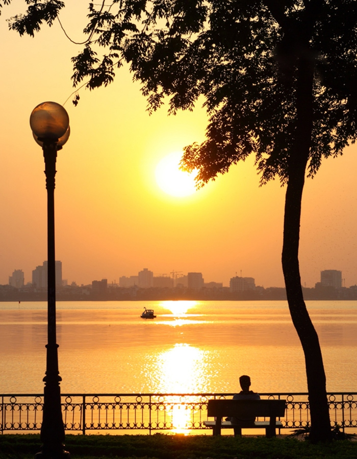 sunset at ho tay west lake hanoi yr