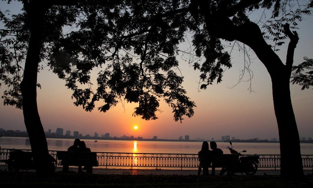 sunset at ho tay west lake hanoi yt