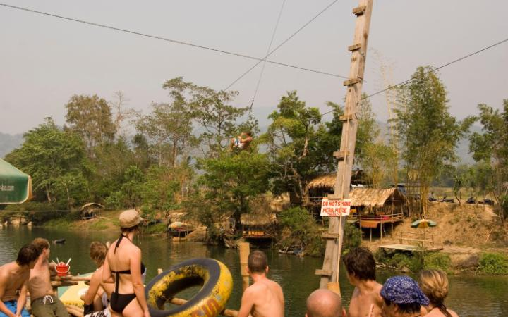 Tourists gather at the tubing hotspot of Vang Vieng, Laos CREDIT: ALAMY