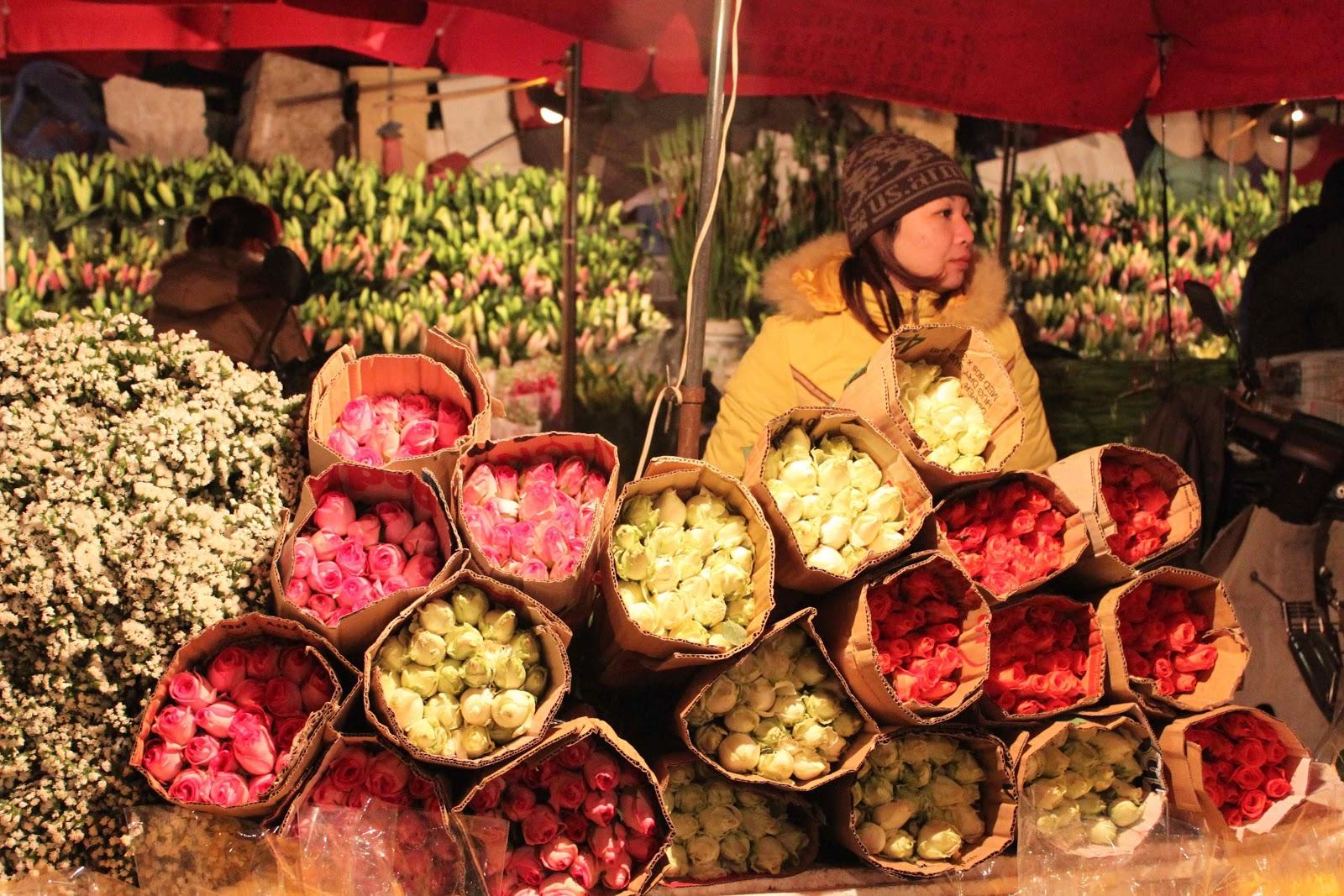 vendors at flowers at quang ba flowers market hanoi vietnam