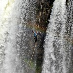 Daredevil slackliner crossing a waterfall in amazing pictures, Brazil