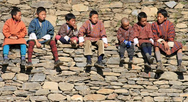 Boys_in_Bhutan_national_dress bhutan travel guide