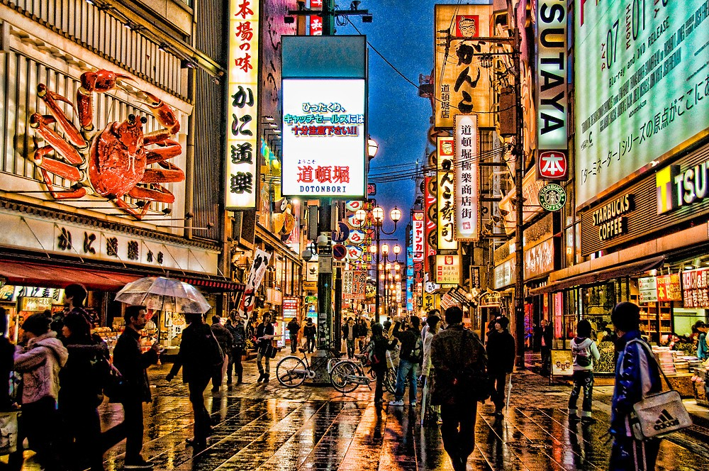 The beauty of Dotonbori in the rain. The famous Kani Doraku crab sign could be seen on the left of the photo Photo: redbubble