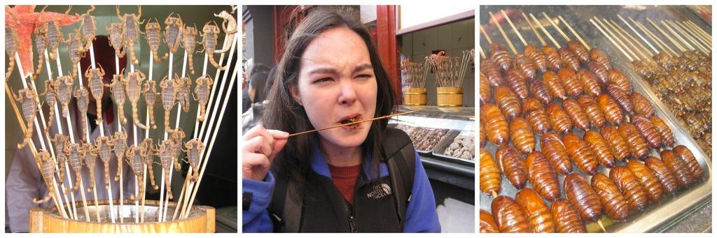 A brave tourist trying fried scorpion in Beijing Photo: baozisandjiaozis
