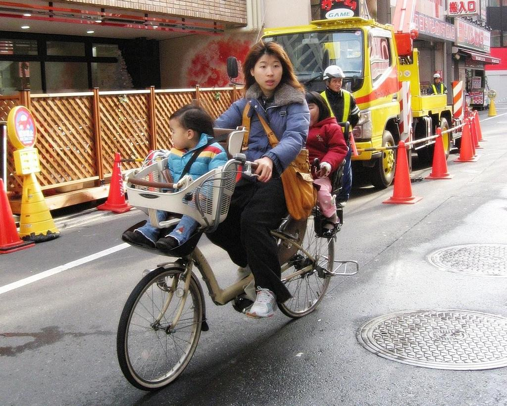 japan woman bikes japanese style travel guide
