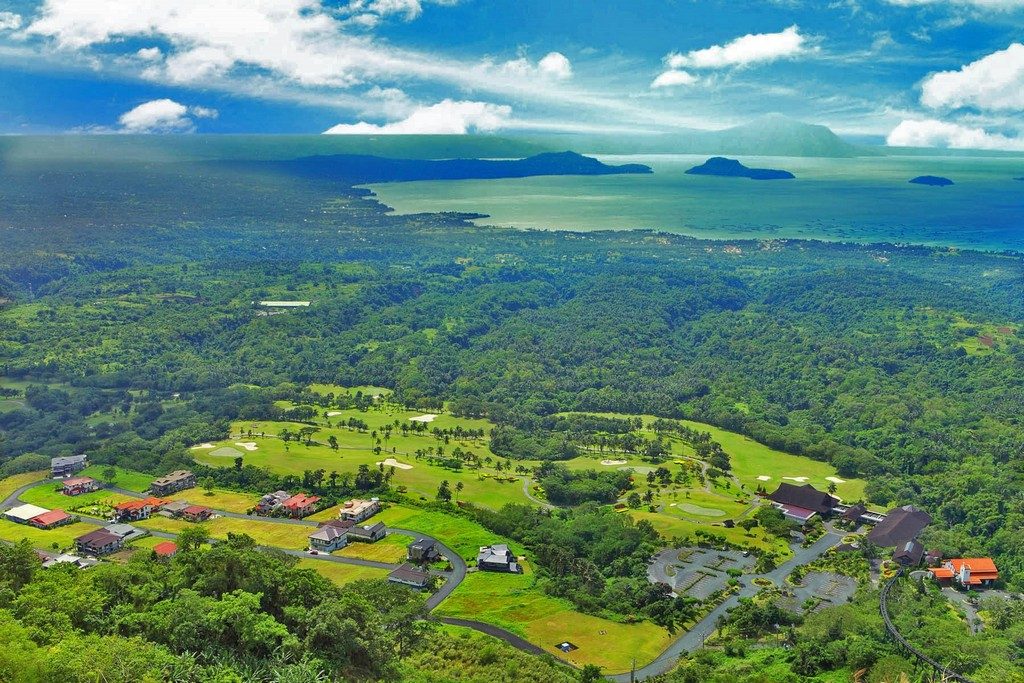 The lush greeneries of forests and grasslands in harmony with the blue of sky and water
