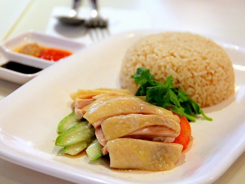 Greasy yellow chicken pieces, soaked in elaborately concocted sauces _Singapore food_Source blogspot