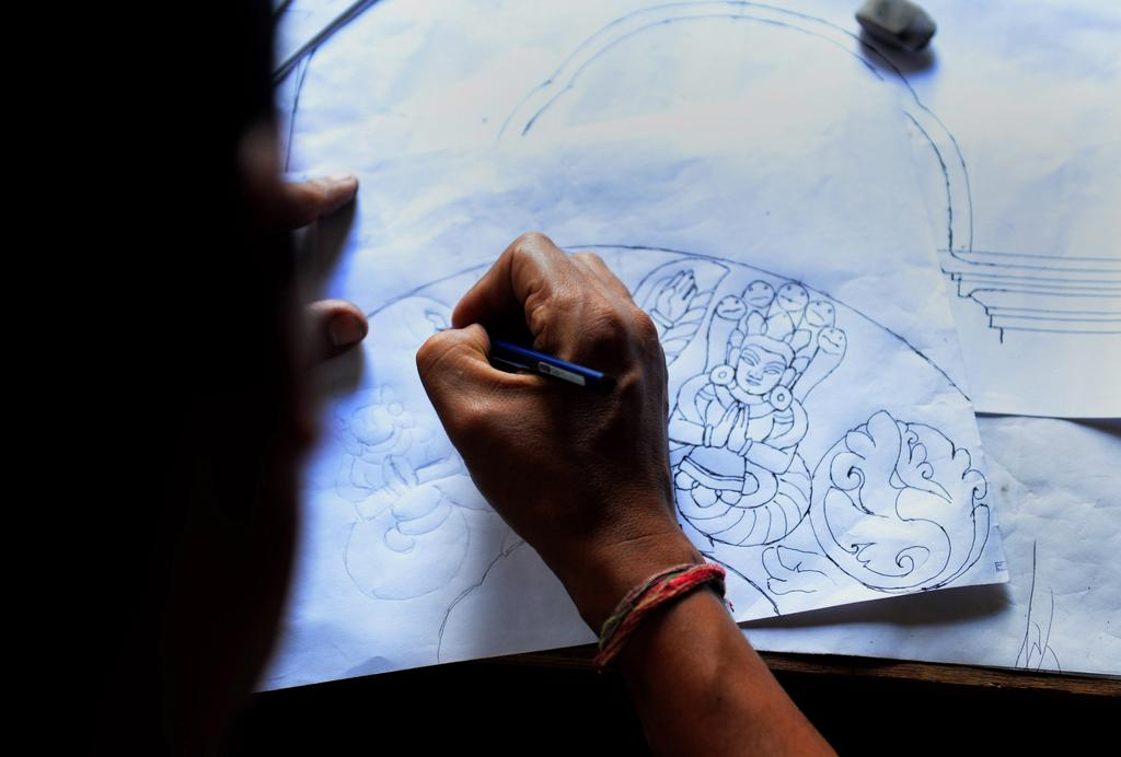 Nepalese woodcarver Hari Bahadur Shilpakar works in a workshop in Bhaktapur on the outskirts of Kathmandu. Prakash Mathema / AFP