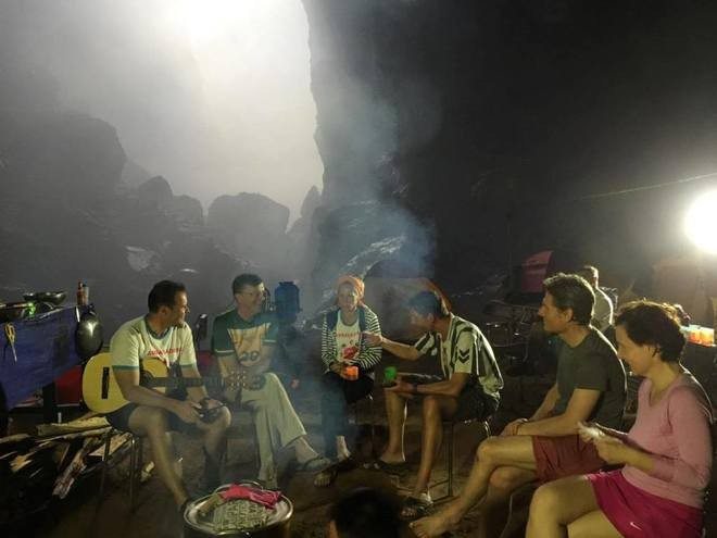 travelers and porters together in son doong cave