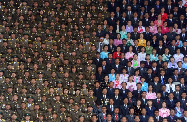 The North Korean military and civilians at the stadium of Kim Il Sung
