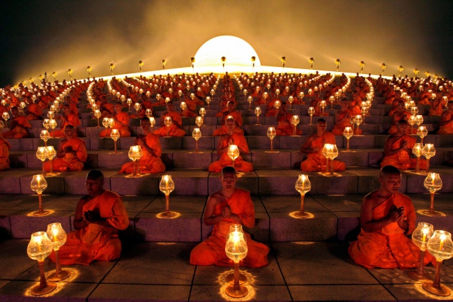 Buddhist monks' ritual before starting the paper lanterns. Suphan Buri Province, Thailand