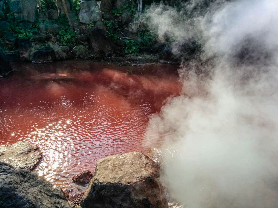 Blood-red-pond-Beppu onsen hot springs japan