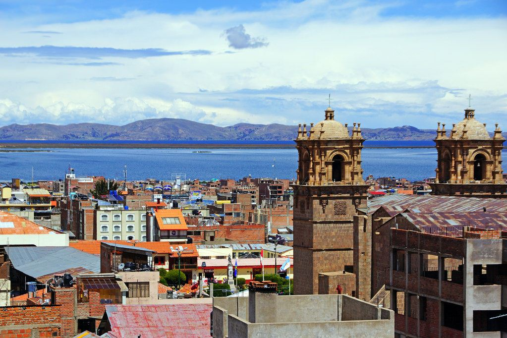 puno cathedral and titicaca lake