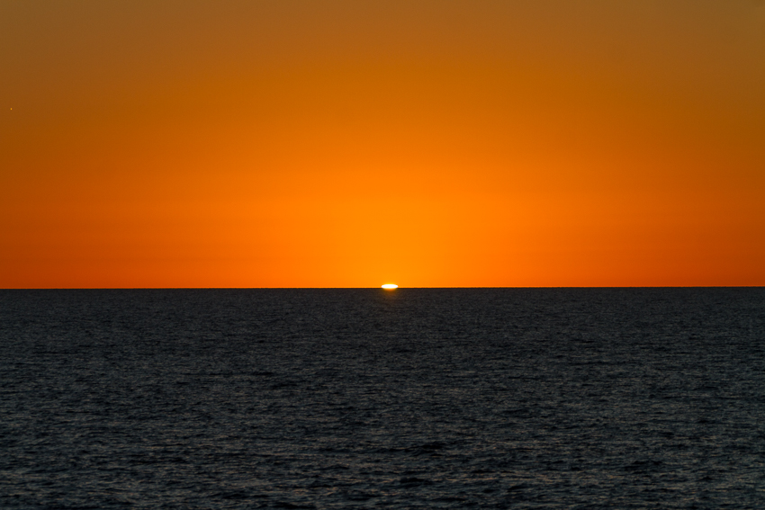 Scenic view of sea against orange sky - Mexico