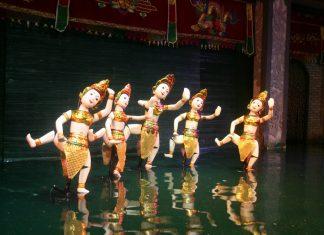 watching water puppet show vietnam travel