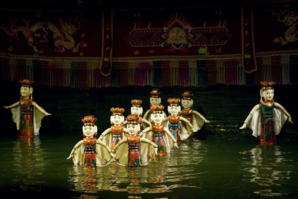 watching water puppet show vietnam travel