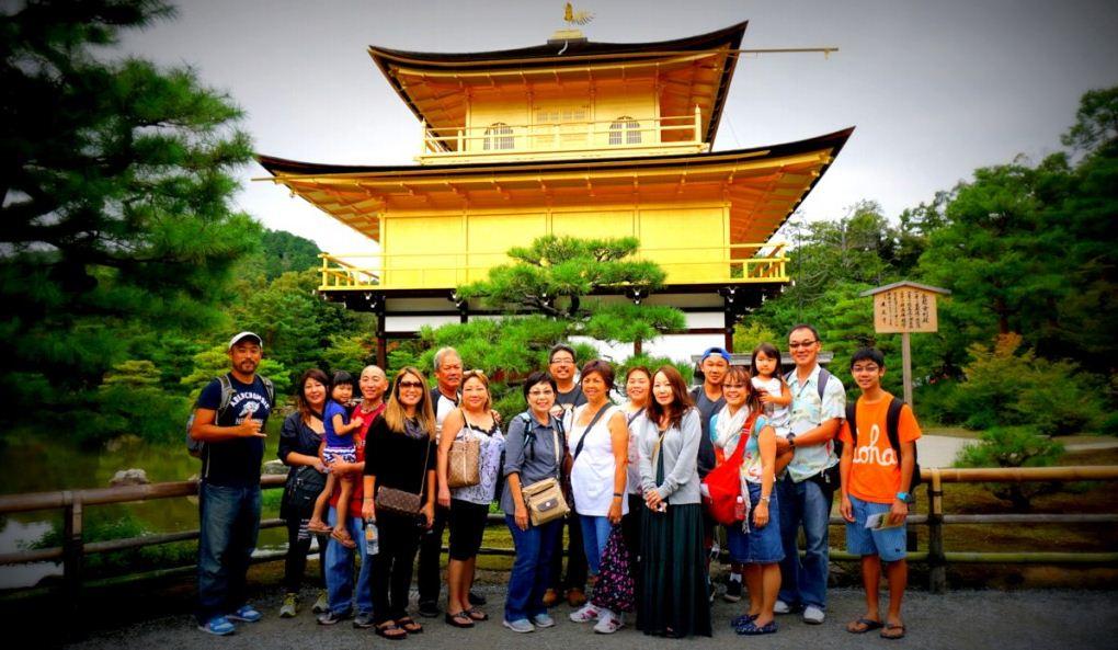 tourist at kinkaku-ji temple