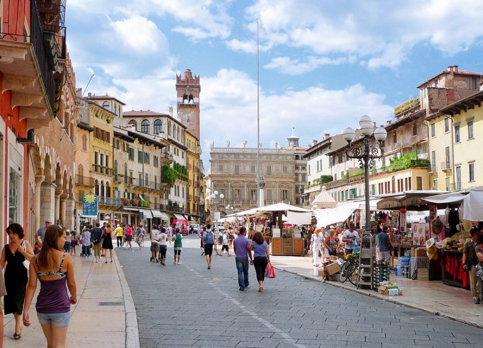 Piazza delle Erbe in Verona buzzes with life