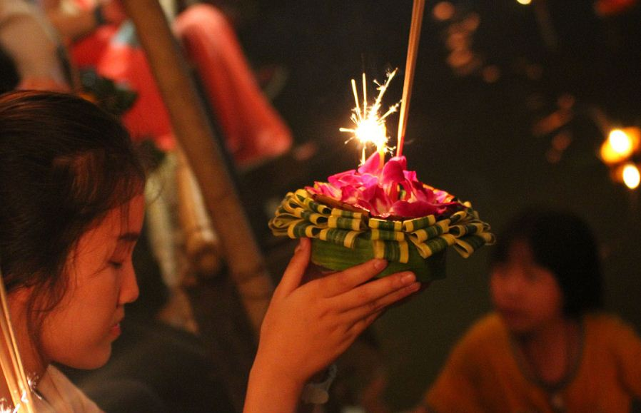 A woman pray in Loy Krathong Festival