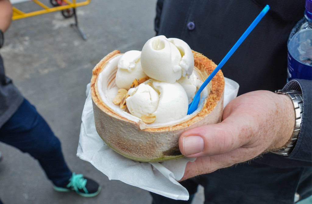 Enjoying the coconut cream, Bangkok . One of the top fun things to do in Bangkok for the first time visitors.
