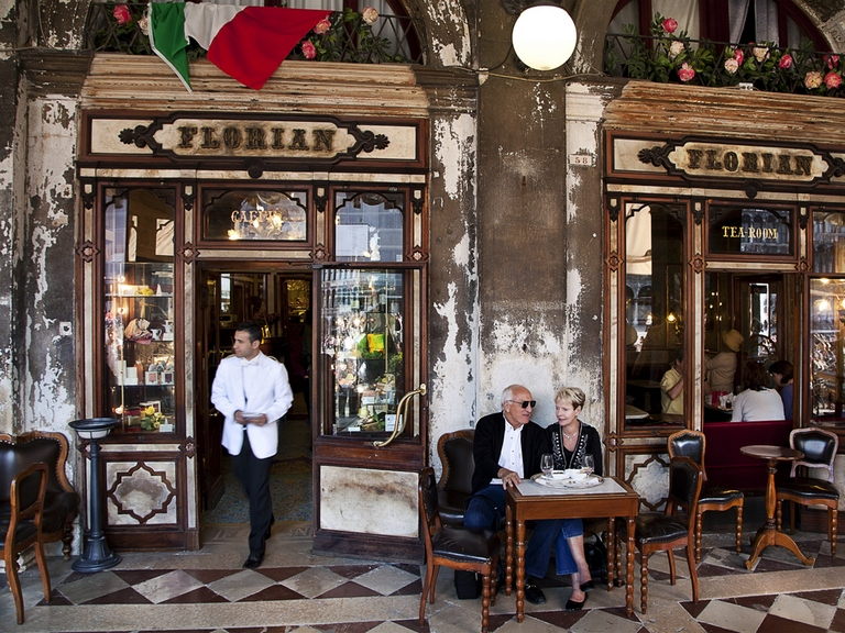 Picture of a couple outside of Caffè Florian in Venice, Italy
