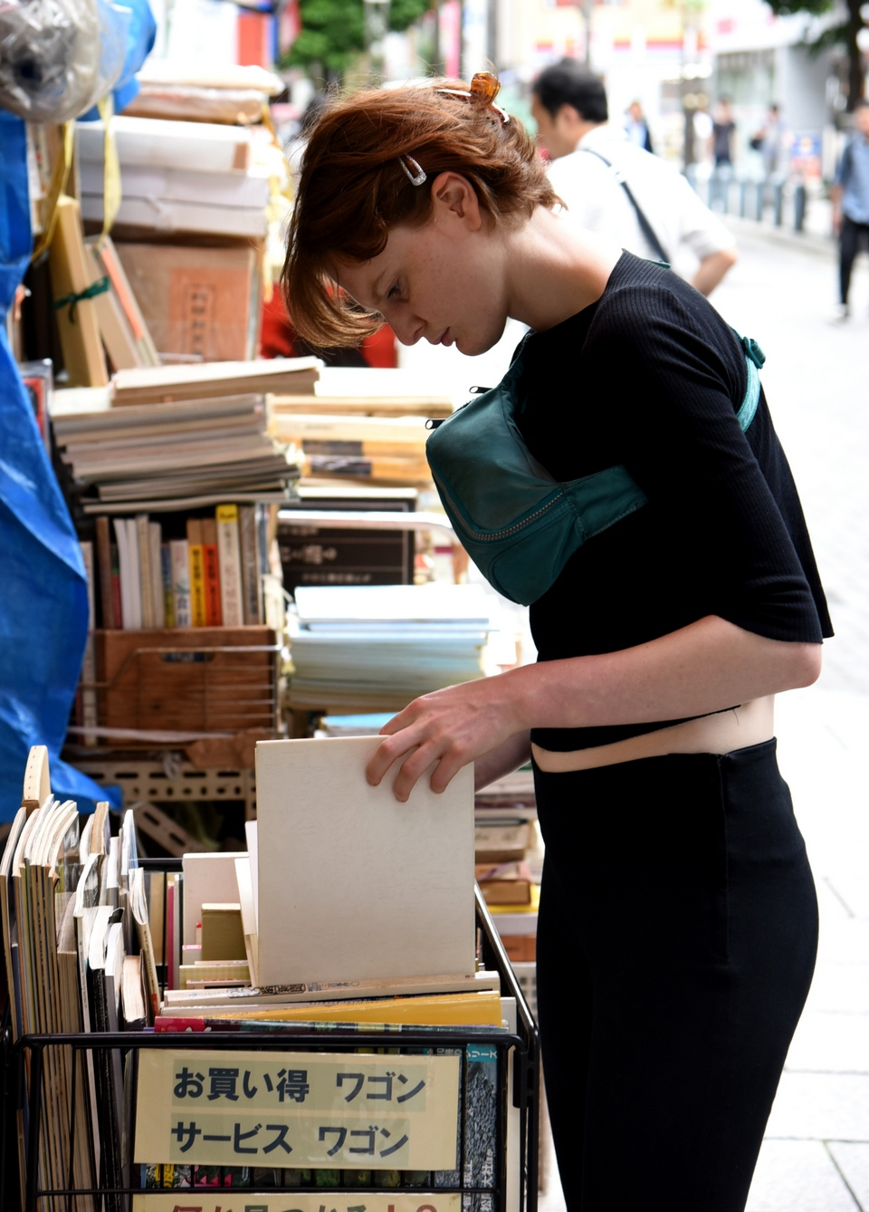 A shopper browses art books at a store selling used volumes in Tokyo's Jinbocho neighborhood.