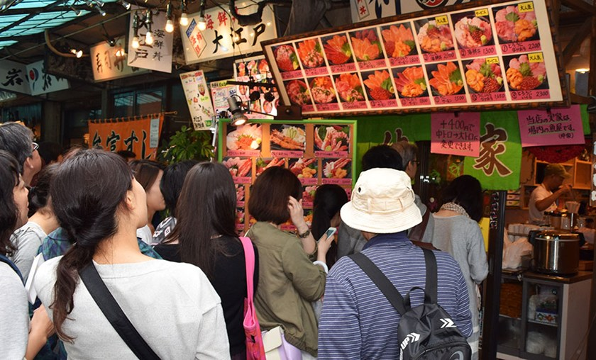 customers line up wait to order food in tokyo