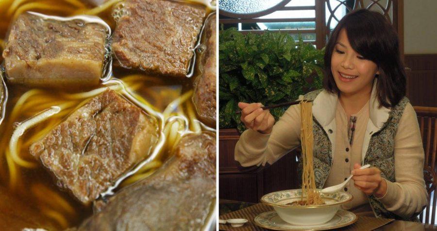 A tourist enjoys Taiwanese beef noodle soup